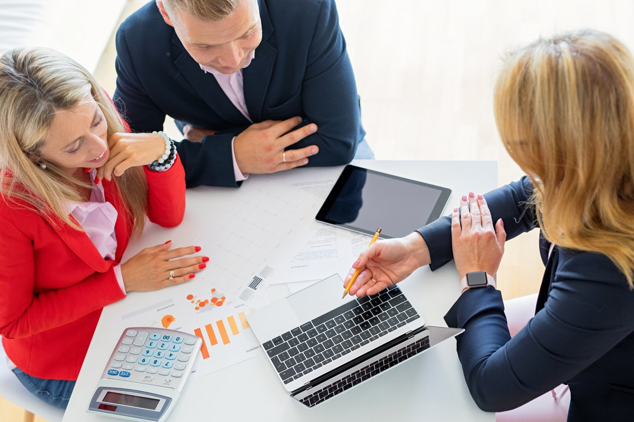 Man and woman getting help from a debt relief professional or financial consultant