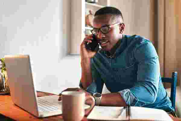 man making a call about Payment Deferral Programs