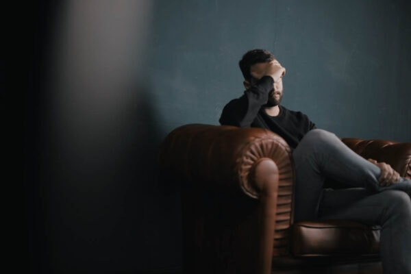 man worrying about debt and his health