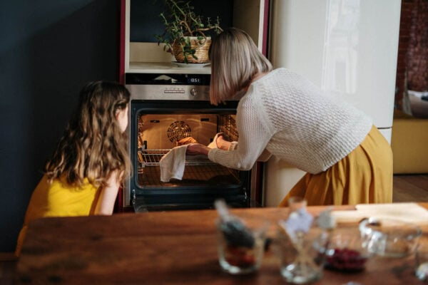 mother and daughter talking about debt and living debt free