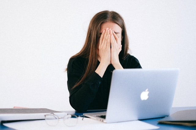 Woman feeling overwhelm about debt