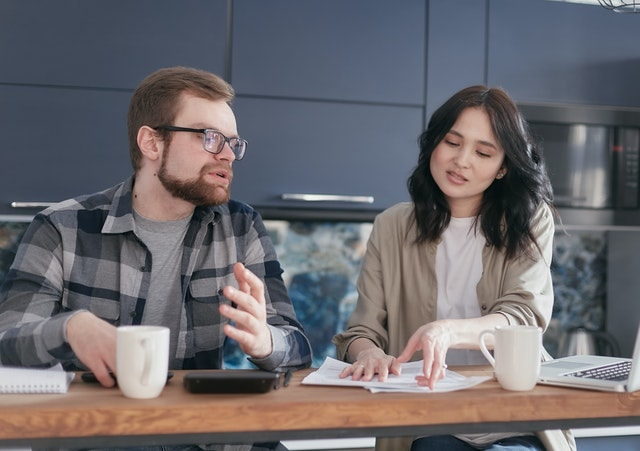man and woman discussing their 2020 tax return