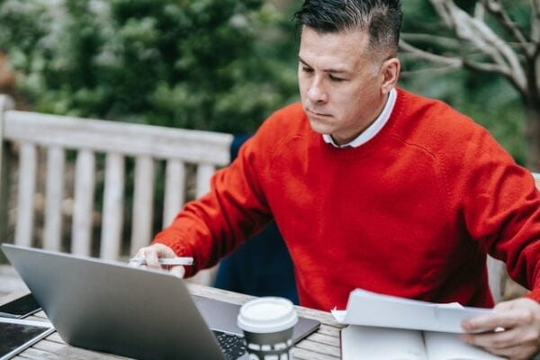 man working on his finances evaluating his debt relief options