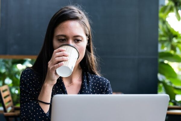 woman on her computer looking at mortgage debt options