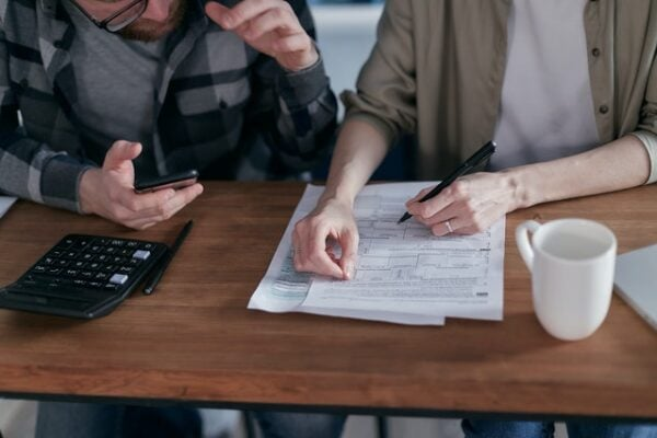 two people making a debt relief plan to get out of debt