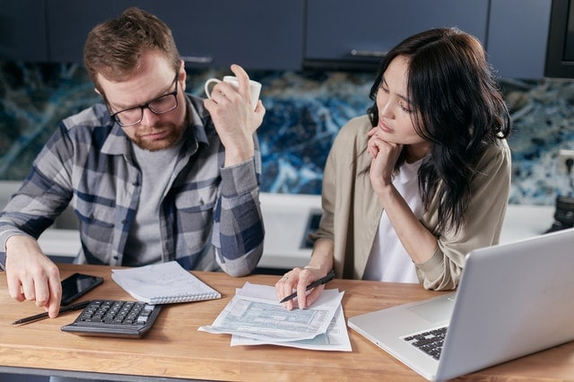 young couple considering a debt relief company