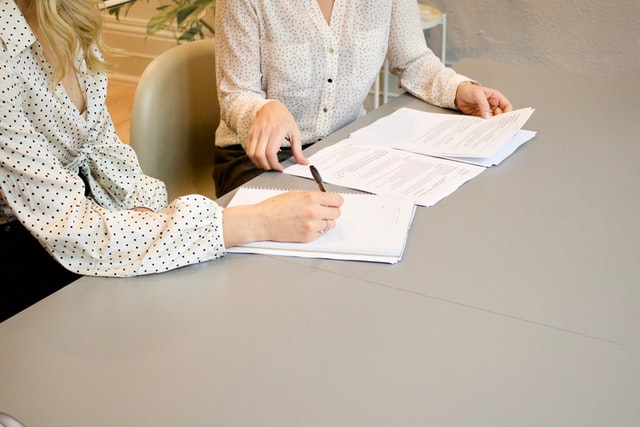 two people reviewing their joint bank account statement