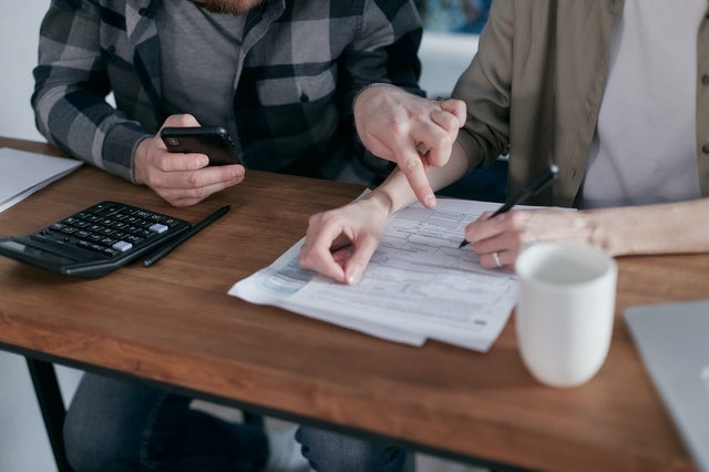couple deciding how to consolidate their debt